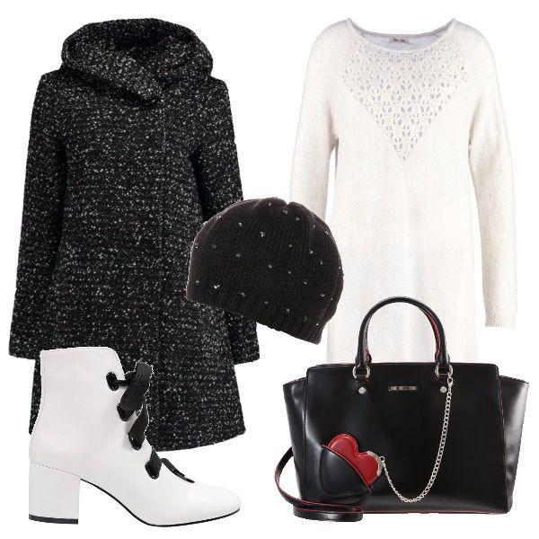 In questo outfit il vestito bianco con particolare lavorazione sul davanti è abbinato a degli stivaletti bianchi con lacci neri, un cappotto corto, una borsa Moschino con l'iconico cuore rosso e un cappellino nero.