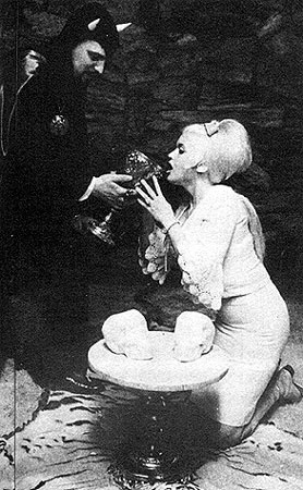 Anton LaVey inducting Jayne Mansfield into the Church of Satan x