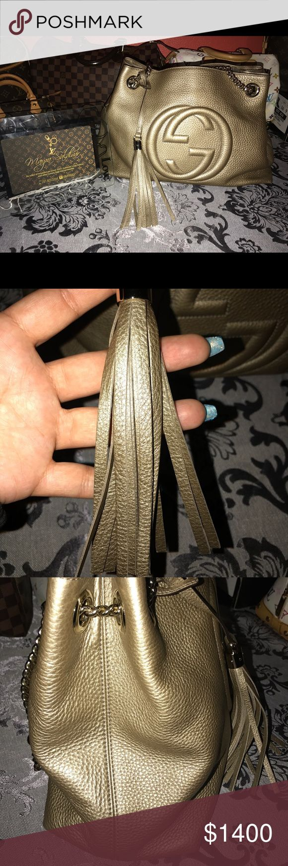 Gucci Hobo Shoulder Bag Gucci Soho Style very nice, this bag is in perfect condition without any use, comes with a dust bag and care book. The iconic 'Soho' style, Gucci's bag is detailed with the brand's signature interlocking 'GG' logo and chunky (detachable) tassel charm. It's made from supple textured-leather and has a beige canvas-lined. Gleaming gold Cross-body chain, strap is the perfect length for wearing on one shoulder, and hottest color of the season for layering whites.  Medium…