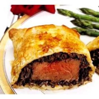 Beef Wellington  I always see them make this on hell's kitchen! I want to try it so bad!