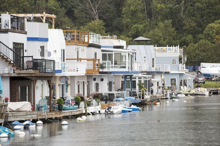 A row of houseboats in nautical-colours, at the Bluffers Park Marina, with the greenery of Scarborough Bluffs rising off in the background, on a rainy day. #sweetheartempirephotography