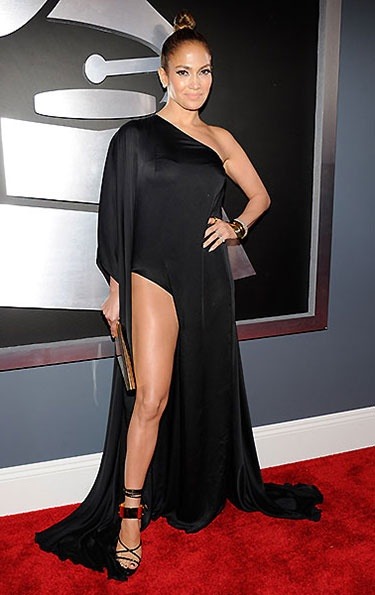 "Jennifer Lopez's take on Grammy's dress code fashion? ""They didn't say anything about leg!"" the star squealed on the red carpet in response to accusations that her one-shoulder, high-slit black gown by Anthony Vaccarello may be breaking the Grammys ""don't show too much skin"" dress code."