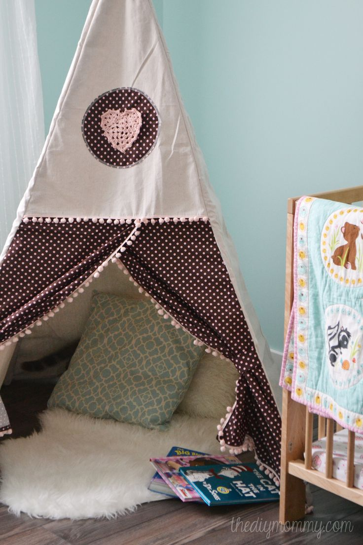 DIY Teepee Play Tent Tutorial by The DIY Mommy. love the curtain opening and the pom pom trim.