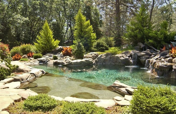Cottage Landscape/Yard with exterior stone floors, Steps and risers, Inter-fab aspen waterfall, Natural rock pool accent