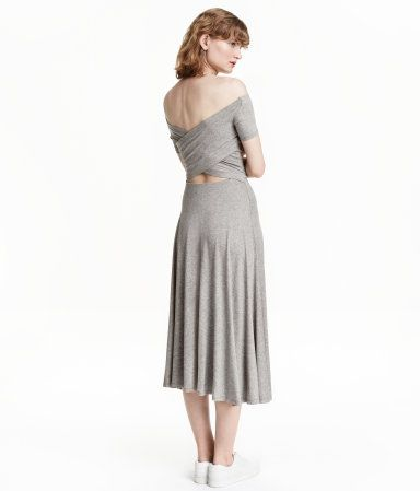 Gray melange. Calf-length, off-the-shoulder dress in jersey with short sleeves, wrapover back section, and elasticized seam at waist.