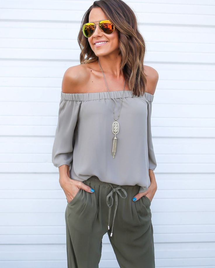 Well isn't this just the cutest top we've ever seen? A gorgeous and chic wheat hued top that exudes the fashion forward off the shoulder trend. A tie on the back adds a sweet touch to this glamorous t