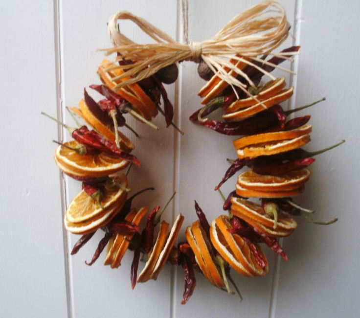 Rustic dried chilli & orange slice wreath  this wreath consists of dried orange slices & dried chillies  finished with a jute string hanger and raffia bow  beautiful bright colours to compliment your country kitchen