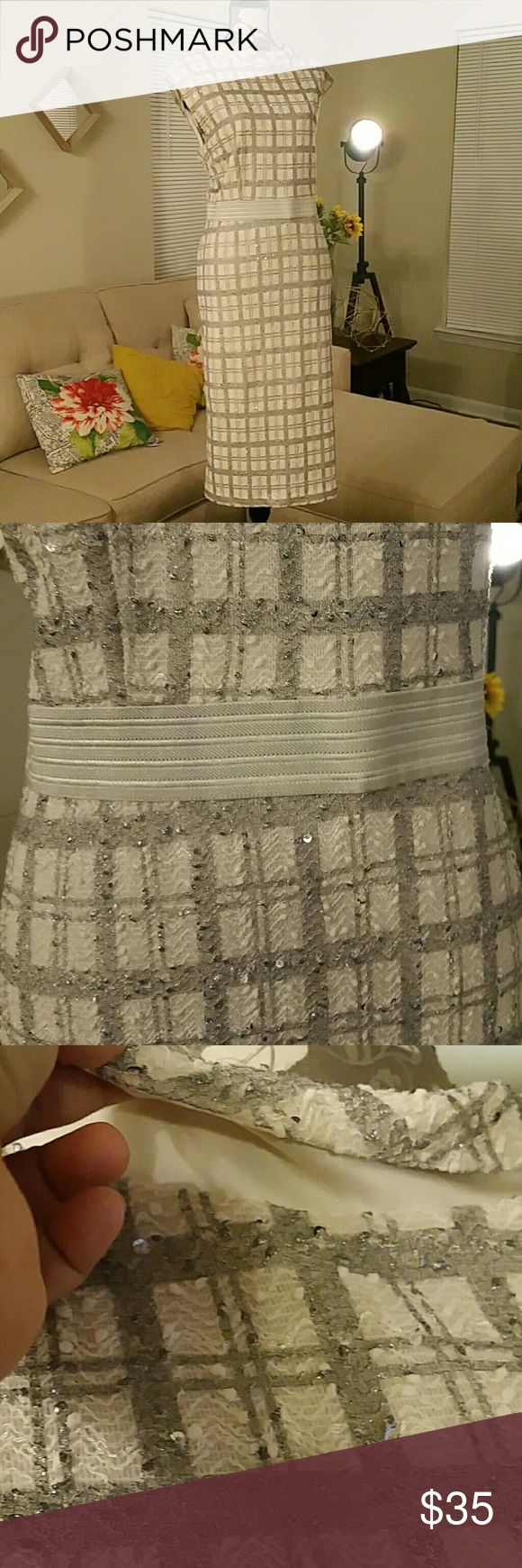 """NY&Co Eva Mendes """"Jackie O"""" inspired dress Size 20 97%polyester, 3%spandex, 100%polyester lining.Elastic detail waist line ,beautiful neckline with more open back creating a v.Ivory,silver plaid with silver and clear sequins/flecks.Very unique. FITS great.Like new,wore for new years only.I consider this a prom,party,or special event dress but it could also be church or a night out dress.Eva M for NY&CO.This dress is a treat! Eva Mendes Dresses Prom"""
