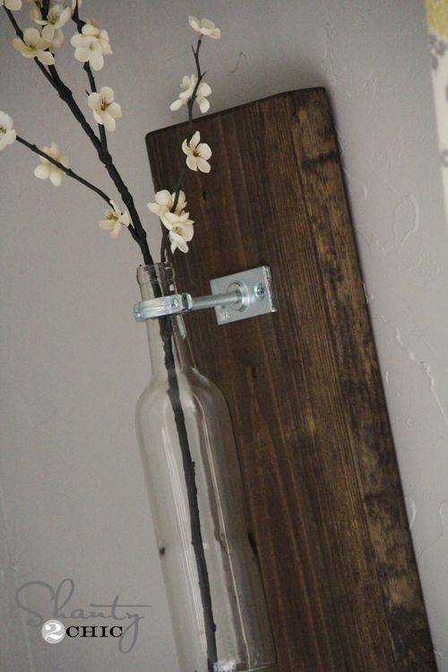 Hanging wine bottle vase. Great use for all of those empty wine bottles headed for the recycling. I've made several variations of this and love the simple, rustic look they give to the room!
