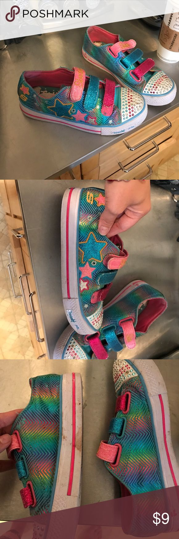 Girls Sketcher Twinkle toes Used still work still have a lot of life my wear them long but kids are hard in shoes so they arnt perfect. They would be a great add on if your purchasing something else from my closet. Sketcher Shoes Sneakers