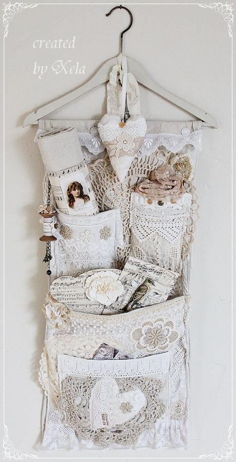 Wall organizer, handcrafted with vintage lace, fabric, and buttons. Pockets filled with more vintage loveliness. Created by Xela, of Cottage Dreams ~ http://cottage-dreams.blogspot.de/