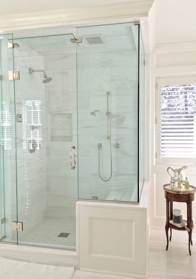 OJC Designs, Inc. -white paneled bathroom with Waterworks Amelie and Julia  fixtures