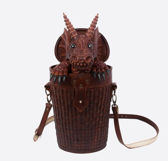 Thumb bob basset brown dragon leather bag backpack 1. I can't believe this exists and I feel like I need it!