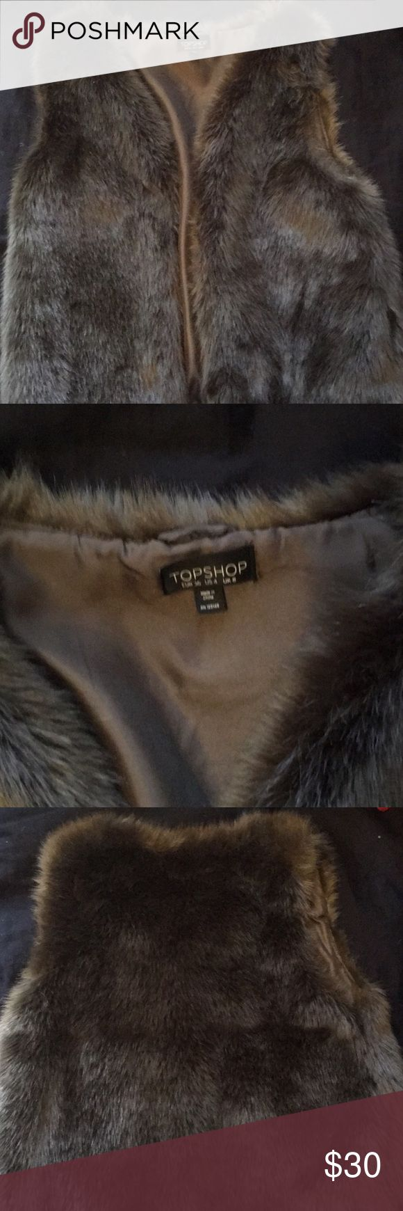 Topshop fur vest Perfect condition Topshop fur faux vest!! Very soft size 4! Purchased from another posher but doesn't look good on me! Topshop Jackets & Coats Vests