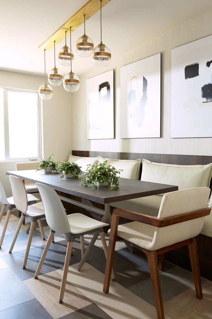built in banquette in neutral gray tones slim rectangular table brass light fixture  tone mixed tile floor in this eat in dining room space: dining room khaki tone