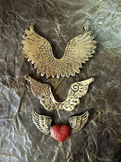 Three pairs of wings made from Friendly Plastic pellets and coloured with acrylic paints and gilding wax.