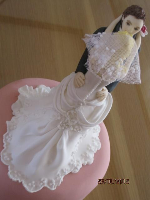 Sugar bride and groom cake topper.  Dress resembles actual dress worn by the bride on the day.  Hand made original sugar cake topper by Tania Riley. Johannesburg, South Africa. 0829316200