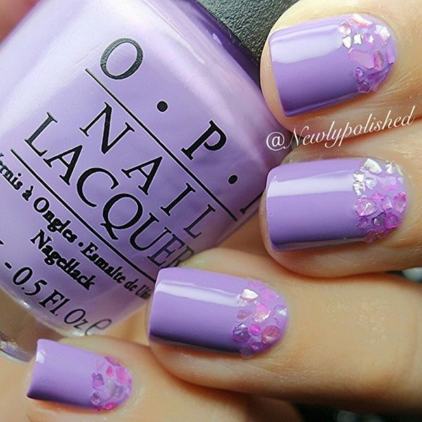 Pretty Purple nail art design with embellishments. The pastel effect of the purple color combines beautifully with the transparent and pink embellishments on the cuticle part of the nails.