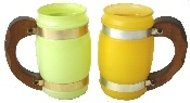"""Siesta Ware Beer Mugs - Pair in frosted lime green and lemon yellow. Each mug features a wooden handle and metal bands. Each mug measures 2.25"""" in diameter and is 5"""" tall. The mugs are vintage and in mint condition."""