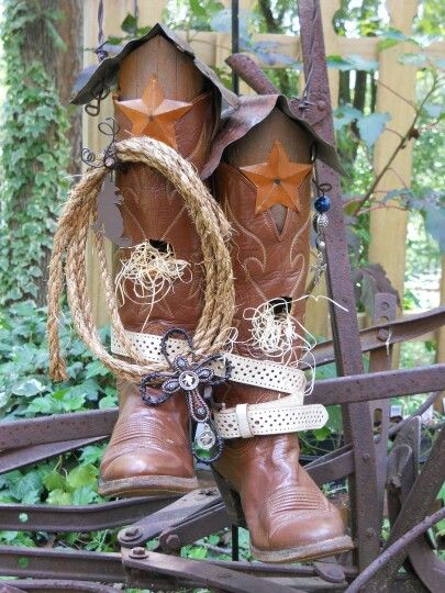 Pair of ladies cowboy boots repurposed into birdhouses. Check out my other birdhouses at Peedledums Primitives.