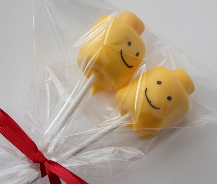 Use a big marshmallow and a mini marshmallow, shove them on a sucker stick and dip them in yellow melted chocolate wafers! EASY PEASY for a Lego party.