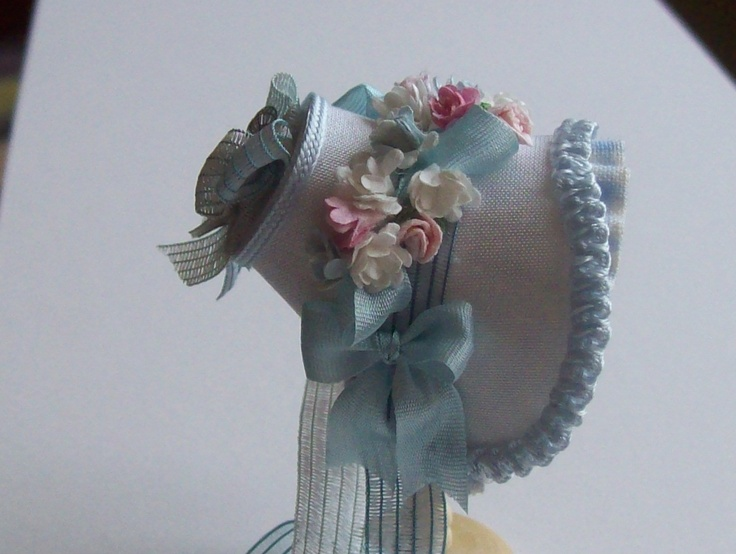 Dollhouse 1/12th scale silk bonnet.  I don't know who made it, but it is wonderful.