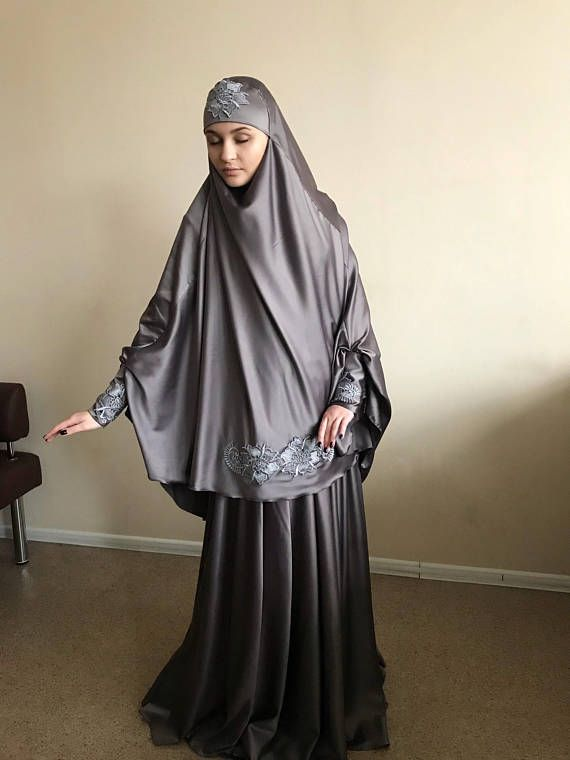 Elegant muslim suit made by soft gray color silk. The costume consists of 2 parts of a skirt and a himar, a waist skirt has an elastic band, a lace trimmed with lace, high cuffs with beautiful buttons. On the photo umbrella style skirt, but at variations we also add cheaper variants