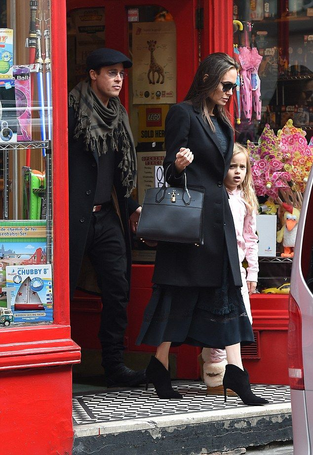 Looking super chic: Angelina, 40, was looking glam for the family shopping trip, wearing her trademark head-to-toe black