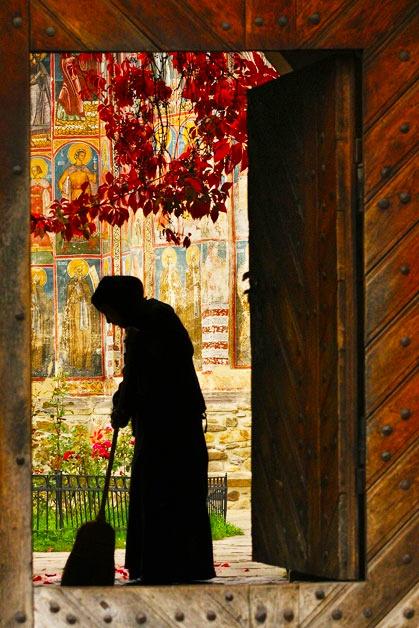 A nun tidies up inside the Moldovita Monastery Cosmin Danila (Brasov, Romania) Photographed September 2006, Bucovina, Romania