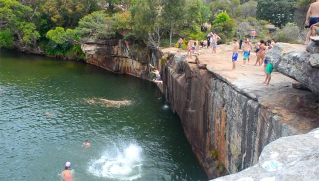Wattamolla Falls - CRISOS    Sydney's least kept secret, Wattamolla Falls is a super chilled location with an awesome summer vibe about it. A beautiful beach, lagoon, BBQ area and rock jump for the daredevils.