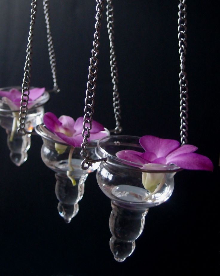 Hanging glass tea light holders offer a beautiful way of adding candle light to weddings and special events, creating a warm and inviting atmosphere for you and your guests. #radiantorchid #candleholders