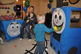 Thomas the train party - I like the game idea but that is one scary looking Thomas!!!