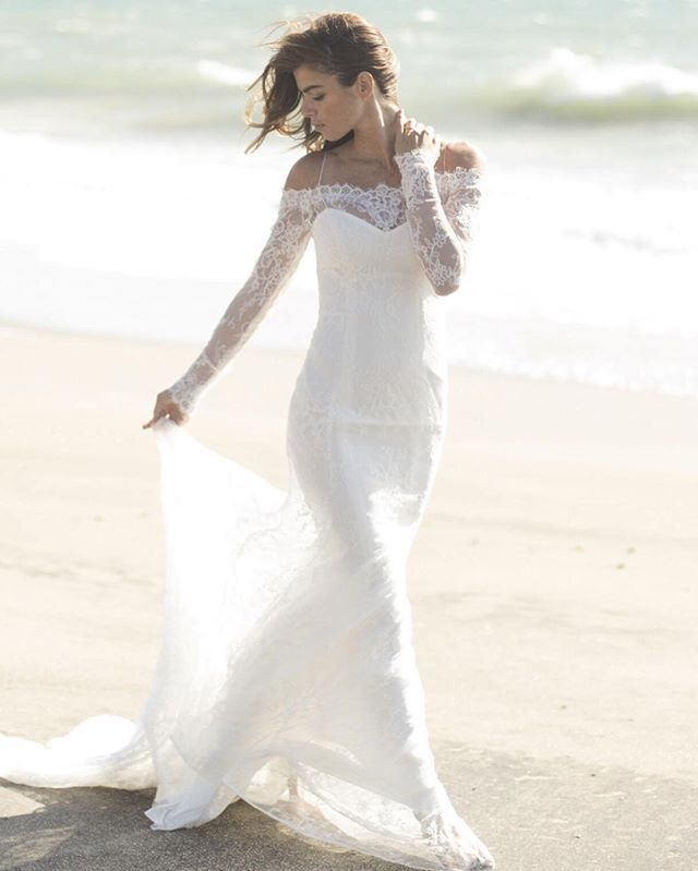Beautiful Beach wedding dress from Christos Bridal Lace off the shoulder wedding dress from Emma
