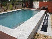 White Granite #PoolCoping. Sparkling white granite used around a pool