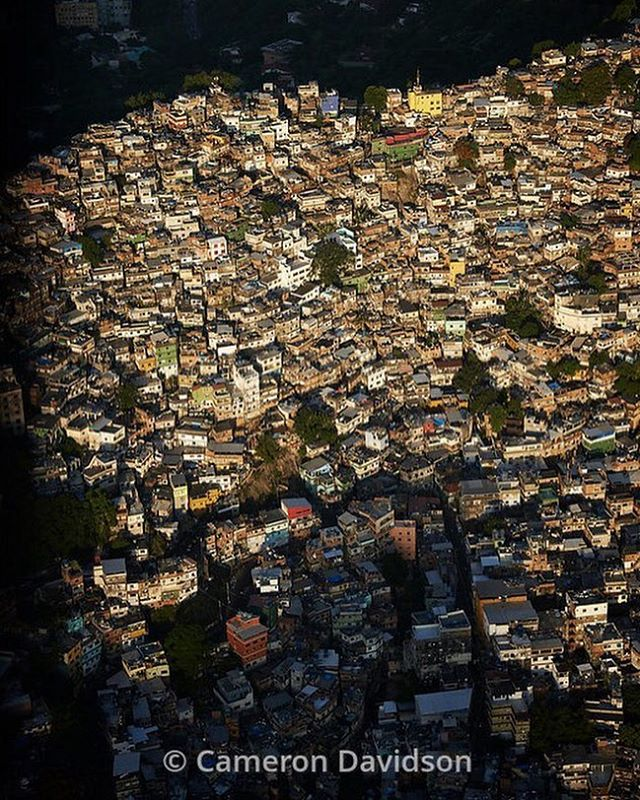 "Photo by @camdavidsonphoto Aerial photograph of  the Favela Vidigal in Rio de Janeiro, Brazil. The Vidigal favela is located at the base of ""Morro Dois Irmãos"" (The Two Brothers )  #brazil #favela #aerialphoto #riodejanero #nikon #olympics"