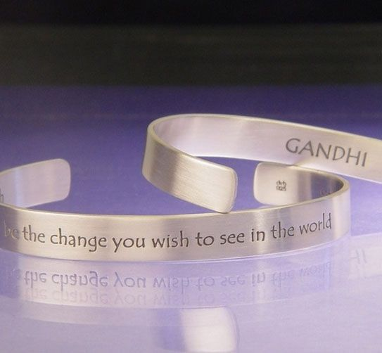 "Be The Change Cuff - Mahatma Gandhi: ""Be the change you wish to see in the world,"" inscribed on the outside. ""Gandhi. Satyagraha. Truth."" inscribed on the inside."
