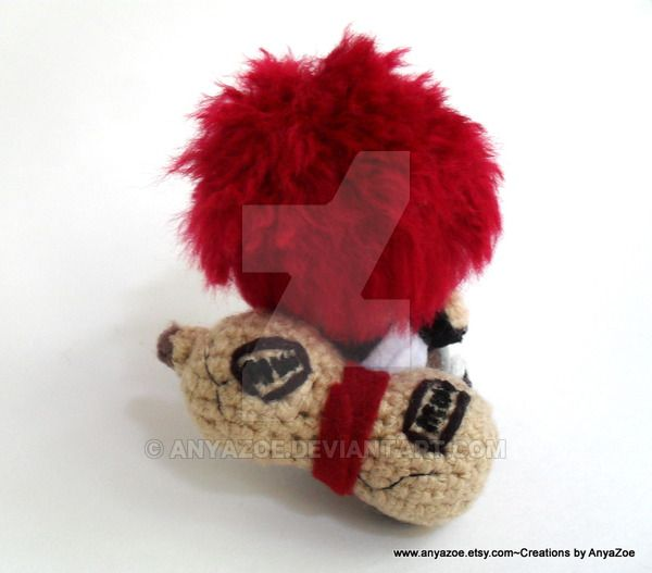 This is my finished Gaara Amigurumi, a custom order for goiku! He is about 4 inches in length.