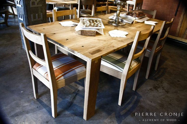 A Pierre Cronje Loft Dining Table With Karoo Chairs