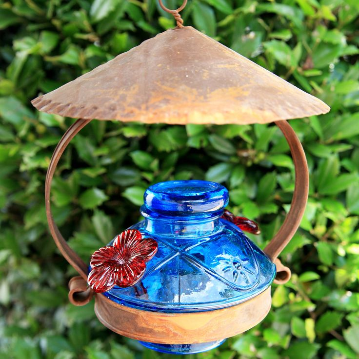 Hummingbird Feeders- Glass hummingbird feeder with rustic tin cupola shelter your birds from any weather.