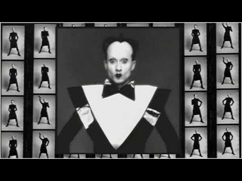 Klaus Nomi sings as the cold genius from Henry Purcell's King Arthur. Baroque. His studio recording was a chilling performance.  What power art thou, who from below Hast made me rise unwillingly and slow From beds of everlasting snow See'st thou not how stiff... and wondrous old... Far unfit to bear the bitter cold... I can scarcely move or draw my breath...  Let me, let me freeze again to death.