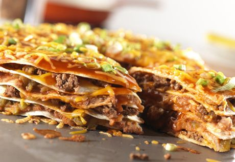 This hearty, one-dish meal features layers of ground beef, tortillas,enchilada sauce, refried beans and shredded Cheddar cheese...it's a wonderfully satisfying dish.
