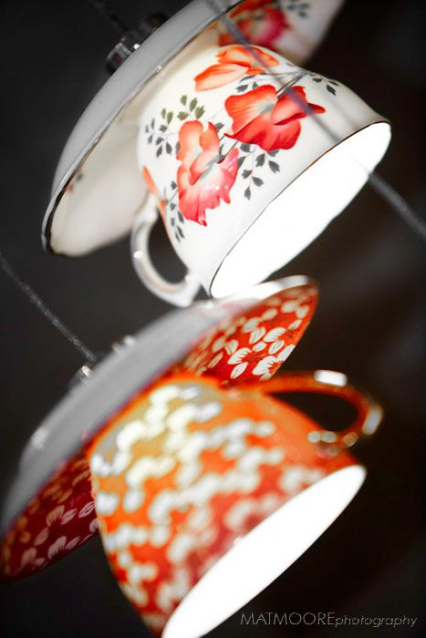 Tea cup lights. Would be fun to try with small LEDs to eliminate the need for cords! Alice in Wonderland party anyone?