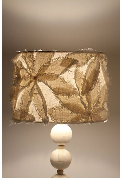 contemporary lamp shades by Anthropologie.  Could I DIY this with modge podge and burlap?