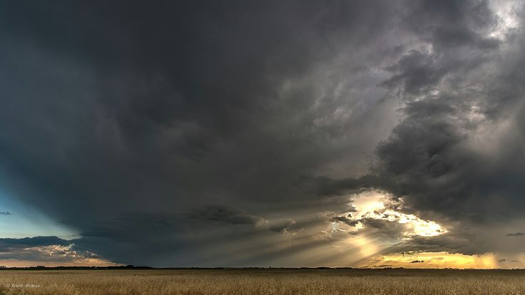 Sunlight peaking through clouds, before the storm hit. East of Winnipeg