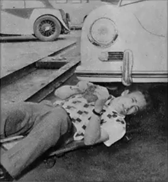 James Dean working on his car.