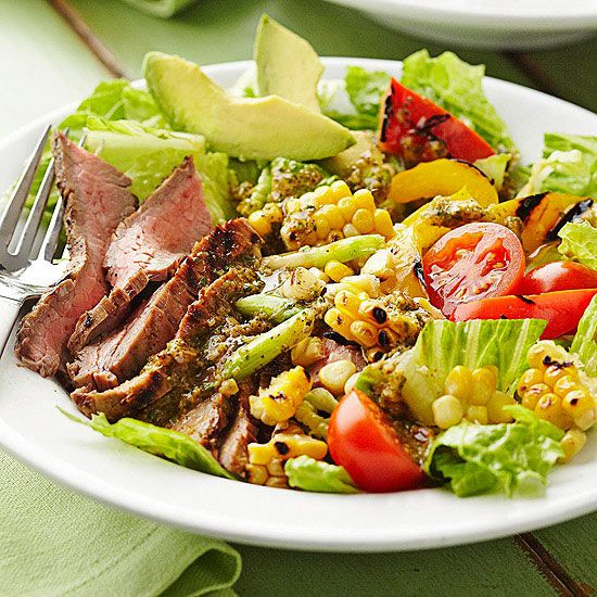 Cilantro, grilled veggies and flank steak add extra flavor to this hearty salad. More salad recipes: http://www.bhg.com/recipes/healthy/dinner/healthy-salad-recipes/?socsrc=bhgpin091513flanksteaksalad#page=5