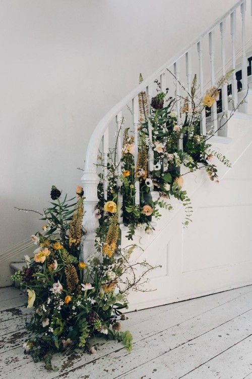 botanical flower arrangement draped up stairs