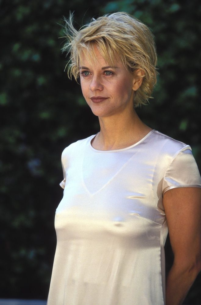 Meg Ryan circa 1994. Red lips and short cut.