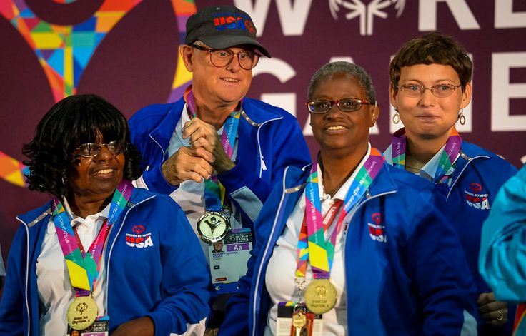 . USA Bocce team, L to R, Mary Davis, Kenneth Skinner, Sheryl Fairbanks and Nicole Landoskey get their gold medals in Bocce team play at the Special Olympics Monday, July 27, 2015. The team went on to defeat Panama and win the gold medal. (photo by David Crane/Los Angeles Daily News)