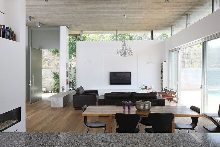 Love the windows between the roof and the walls. House A by Amitzi Architects